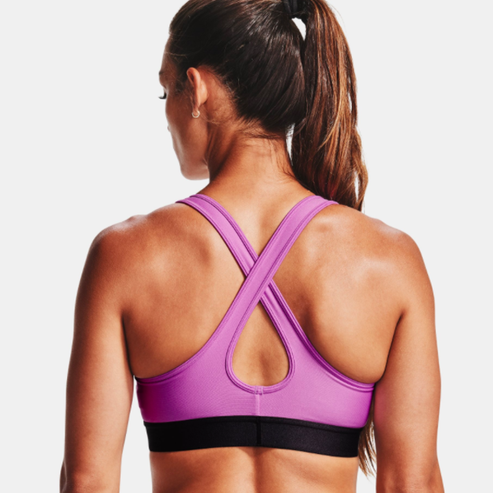 back of model wearing mid crossback sports bra in exotic bloom