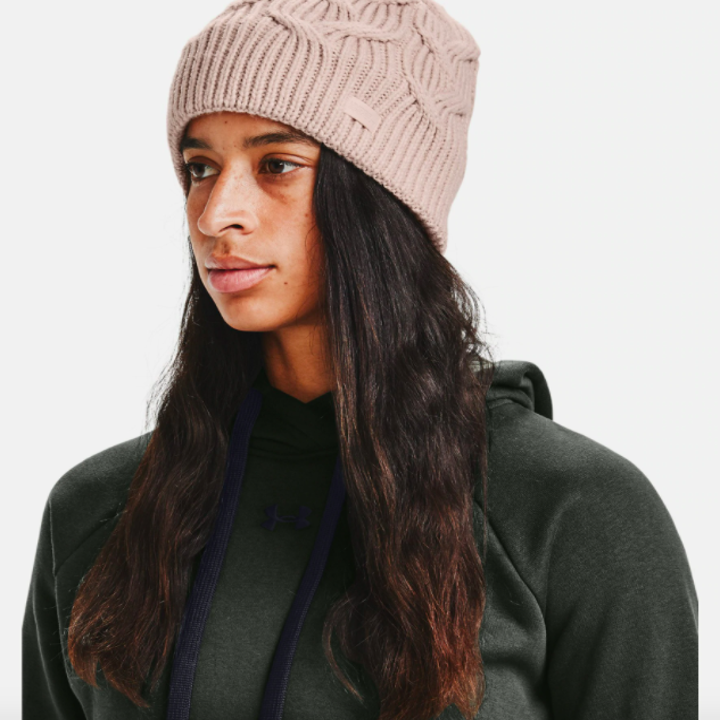 model wearing UA Around Town beanie in desert rose