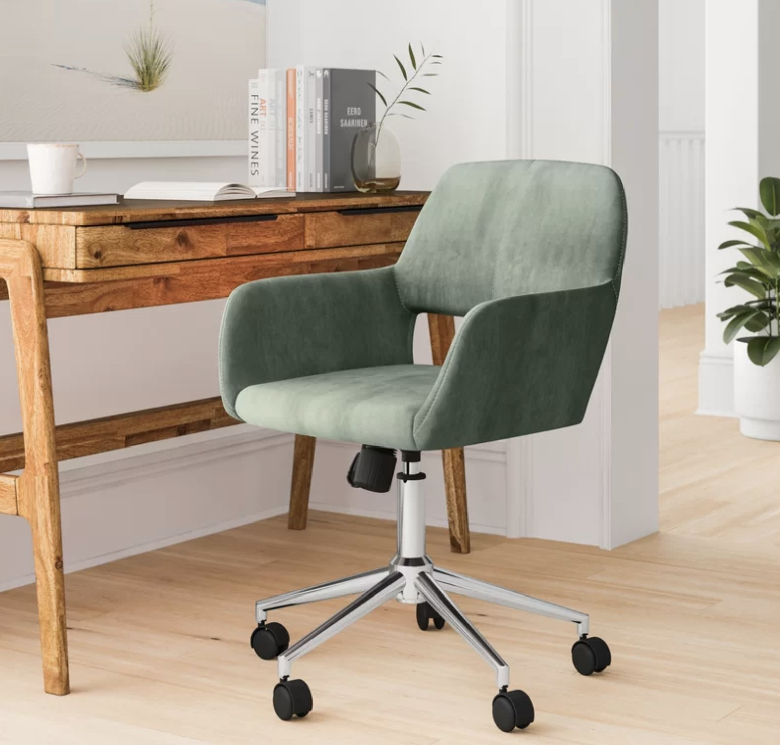 The green desk chair next to a desk