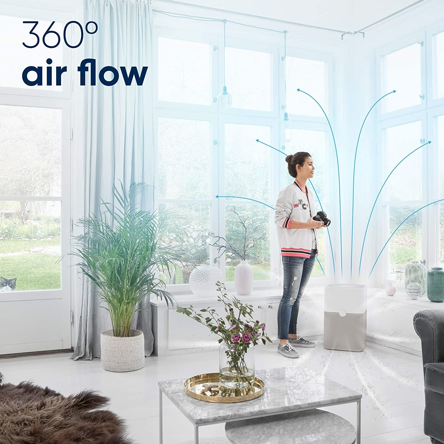 Model standing in a room with white and gray air purifier