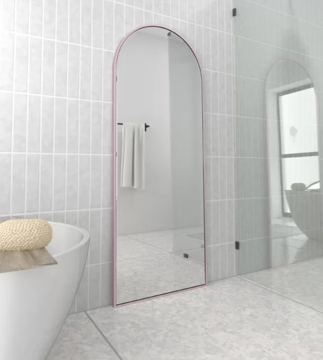 A floor-length mirror with pink trim