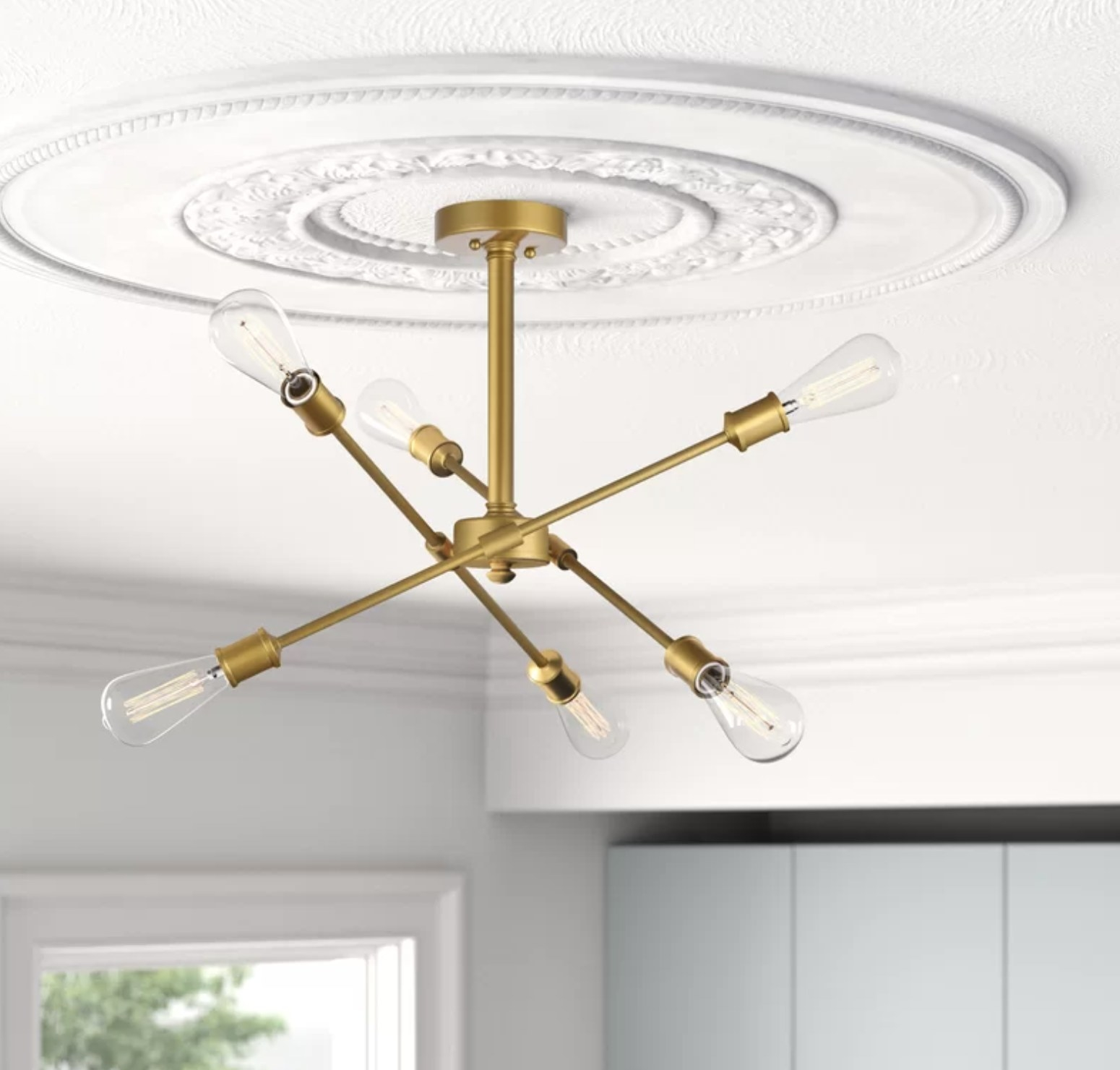 The ceiling light with gold chrome