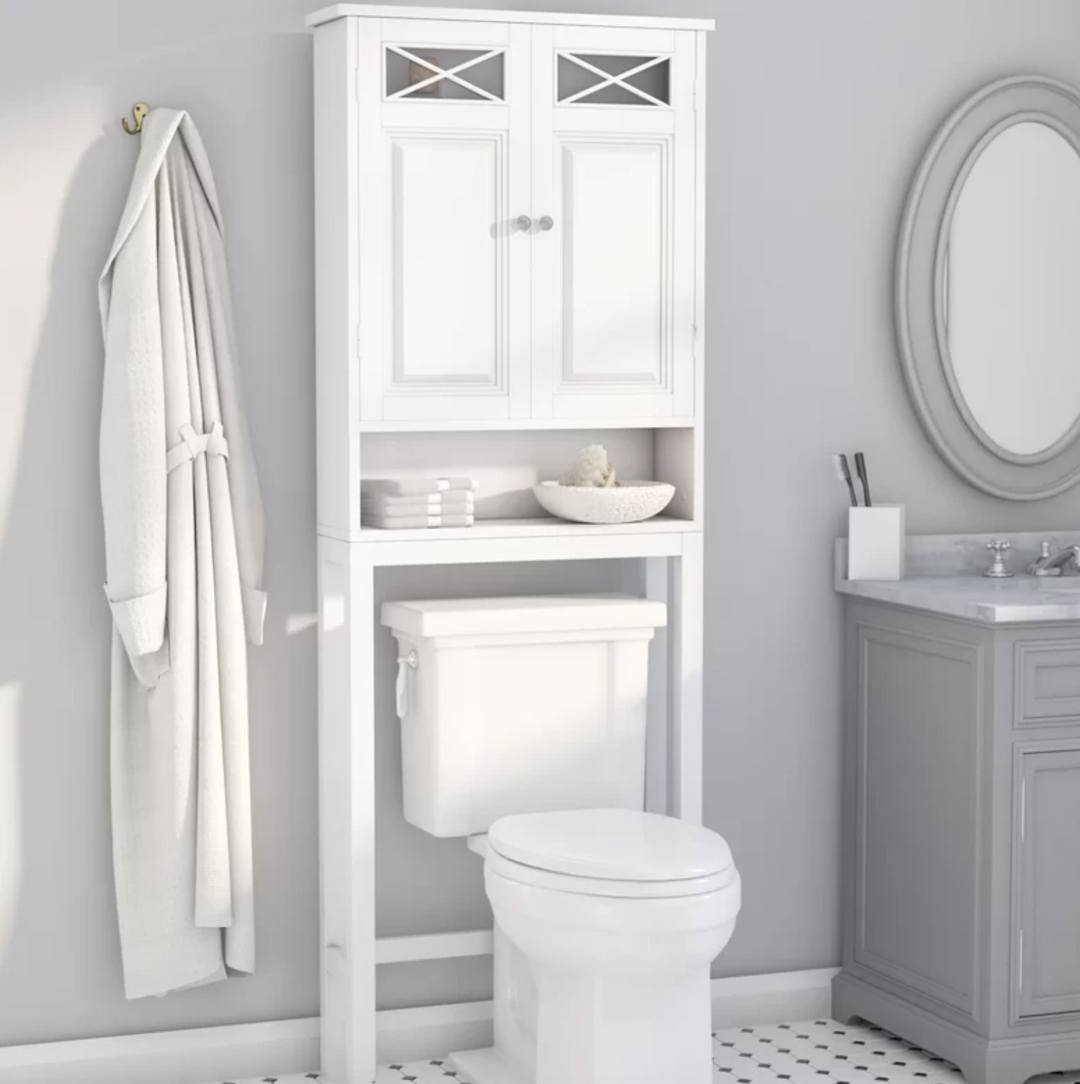 The white storage cabinet above a toilet in a bathroom