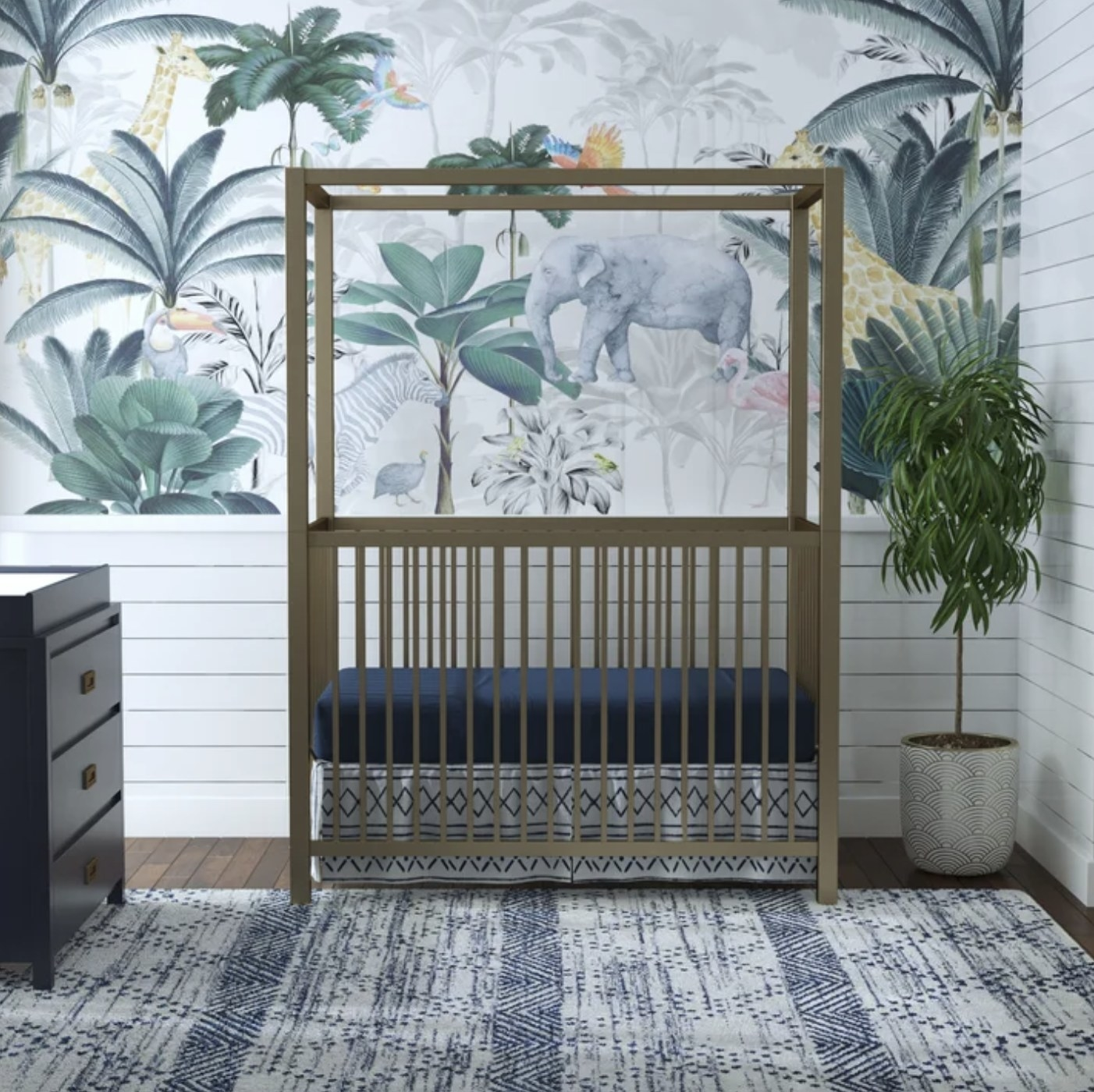 The crib with canopy and gold accents
