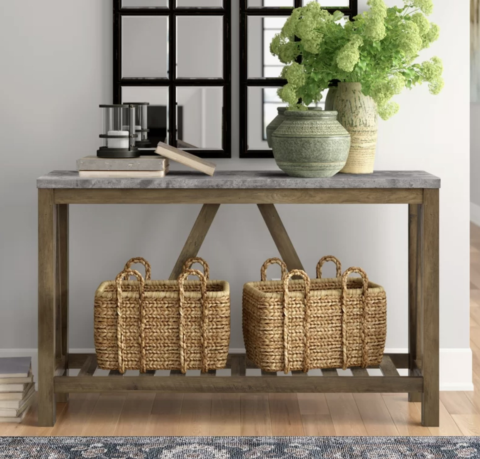The entry way with a grey marble top and baskets on the bottom shelf