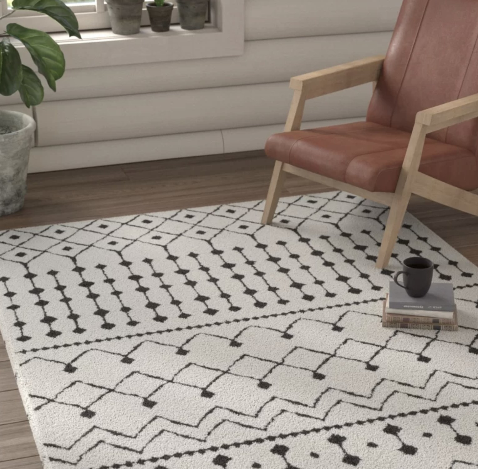 The white rug with black line patterns on it