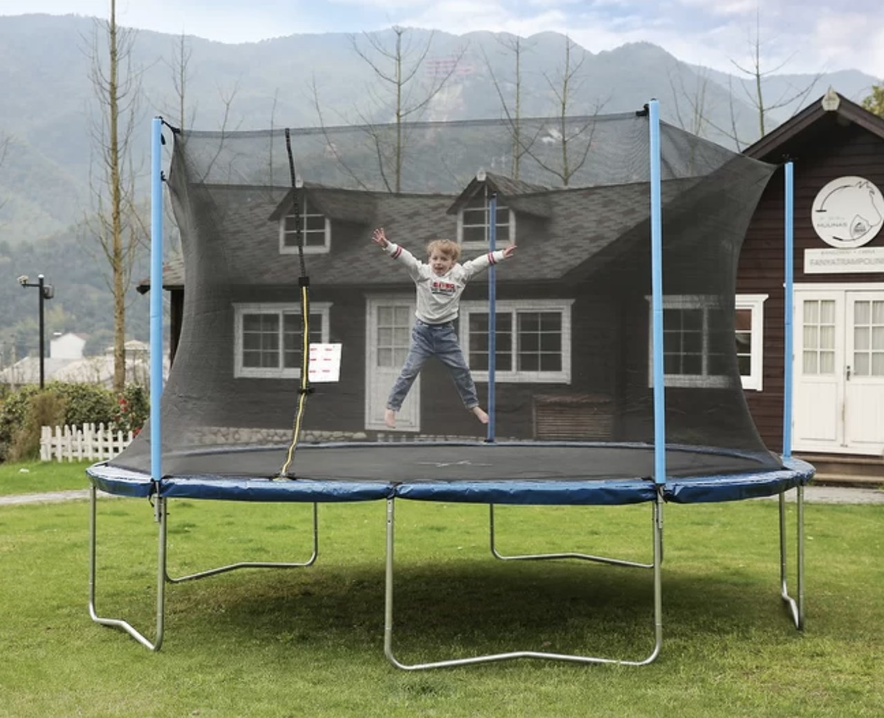 A person is jumping on a trampoline