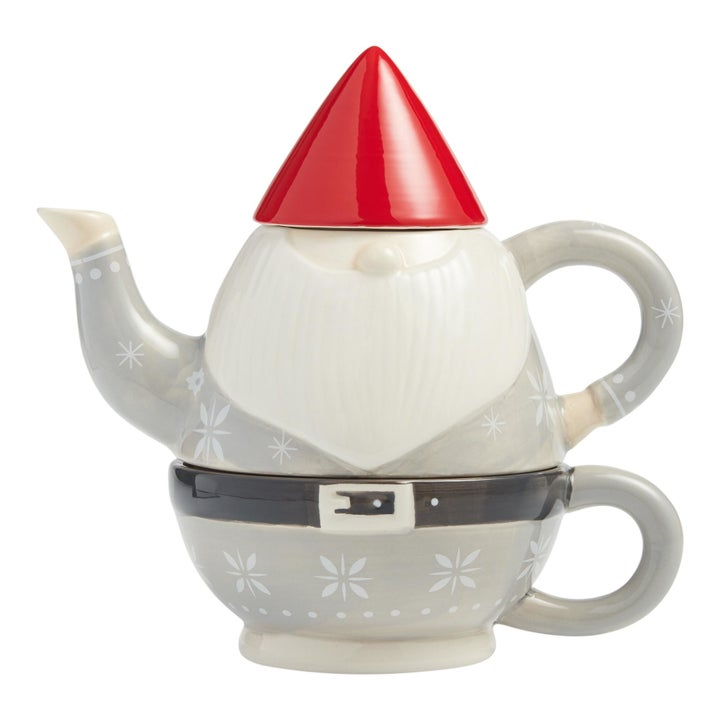 a mug, tea pot, and cover that stack to form the shape of a garden gnome
