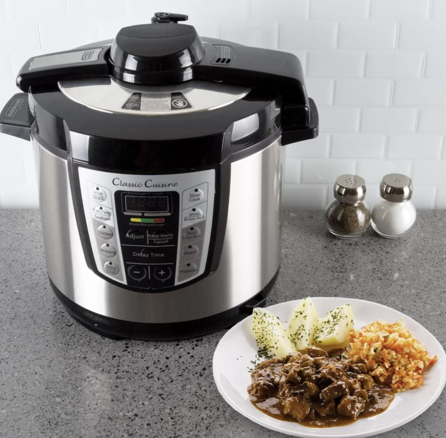 The multi-cooker next to a plate of food