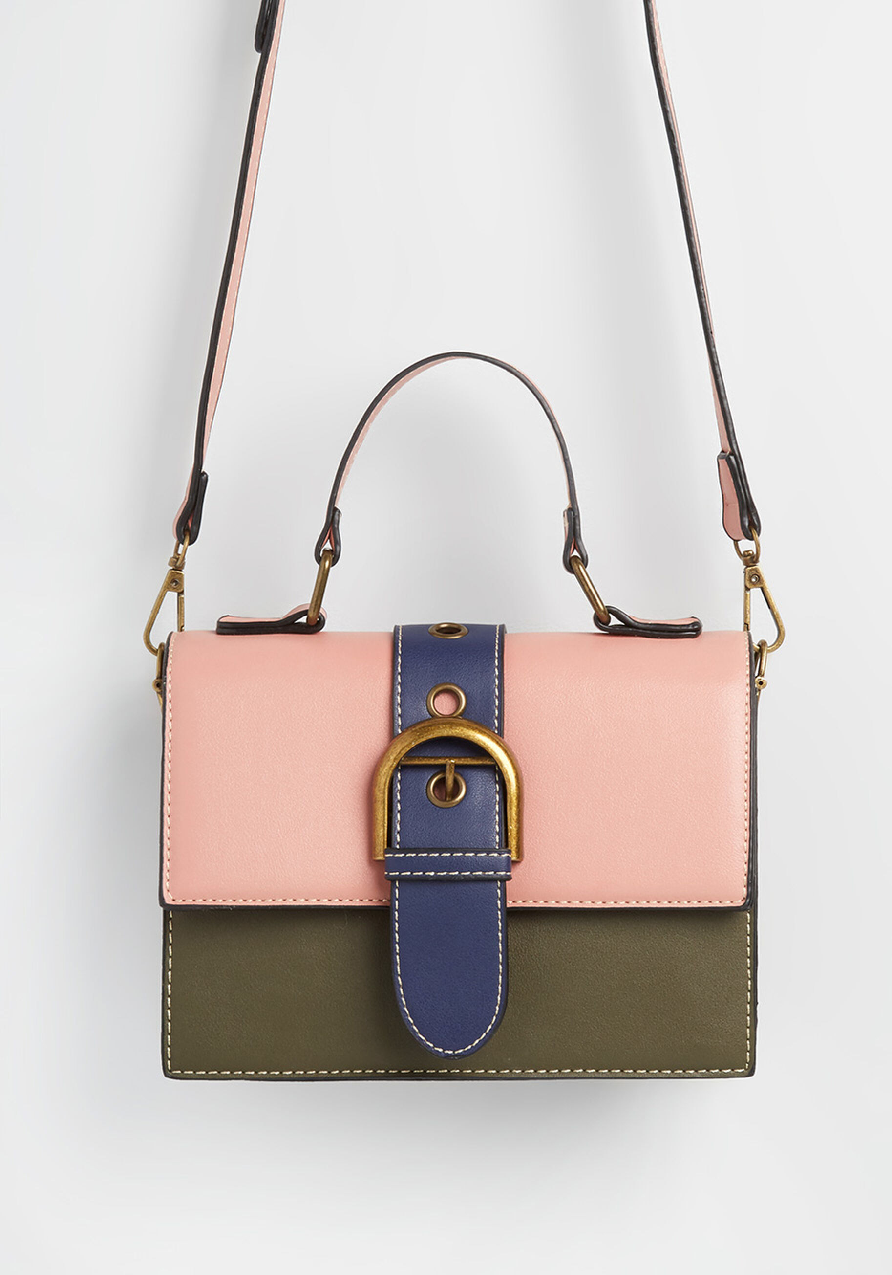 a fold over satchel bag with the top fold pink, bottom half green, and a blue buckle strap