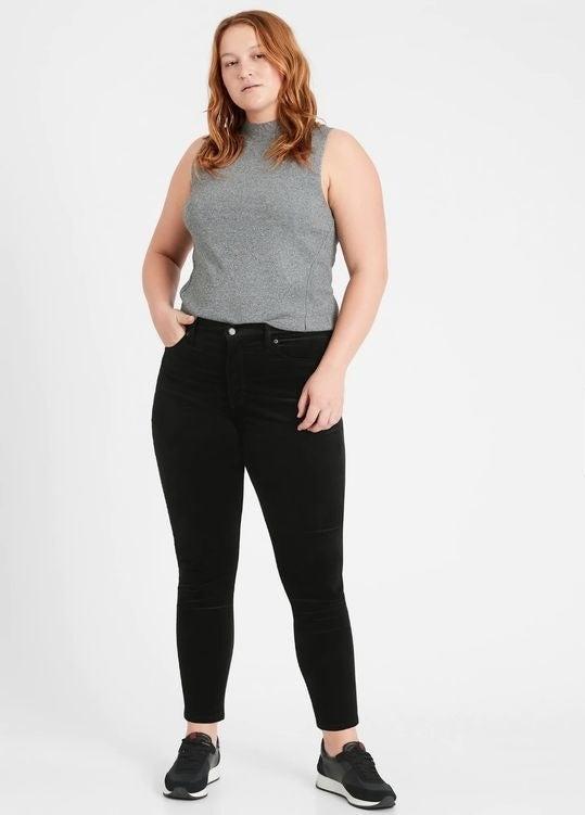 Model wearing the black velvet pants