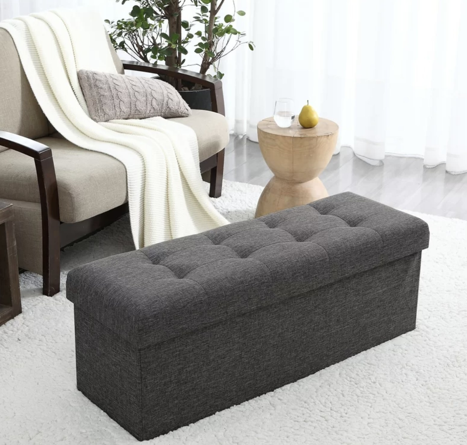 The dark grey storage bench
