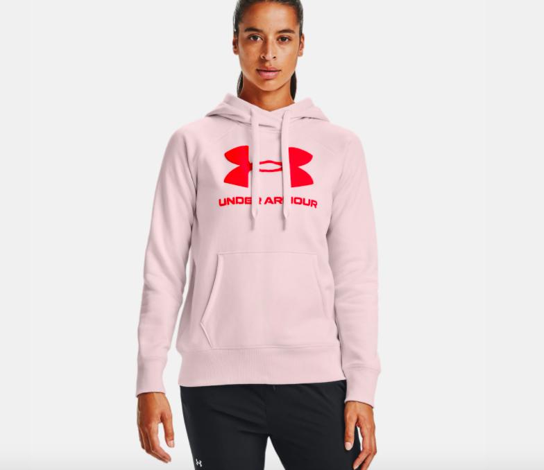 model wearing UA rival fleece logo hoodie in beta tint