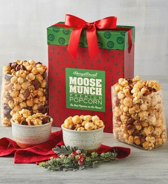 box that says moose much with bowls of popcorn around it