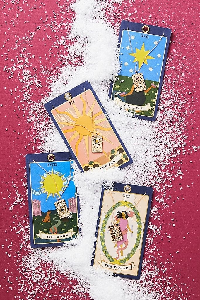 tarot cards with necklaces with small card pendants attached