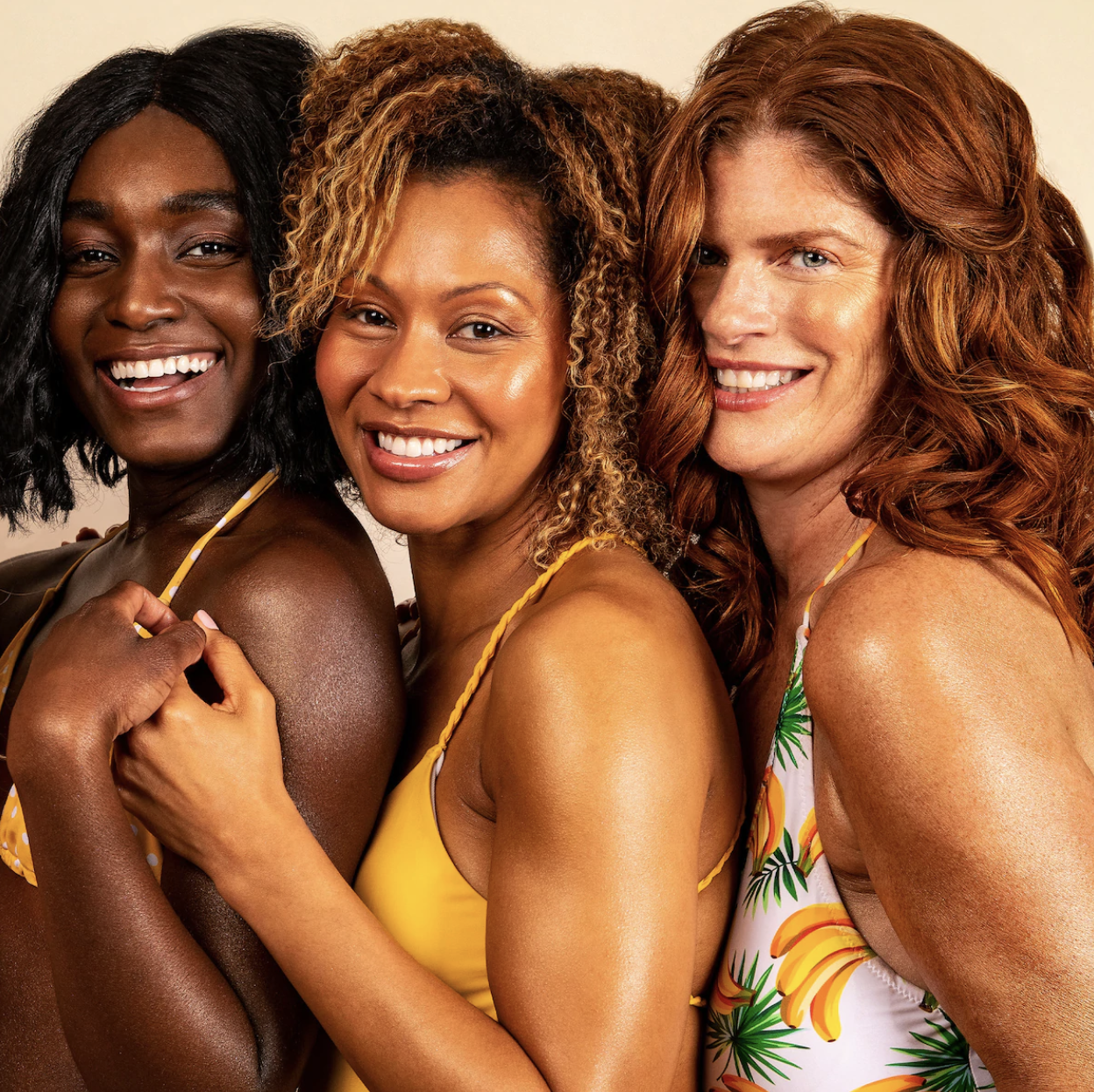 Models with deep, tan, and medium skin tones with glowing skin