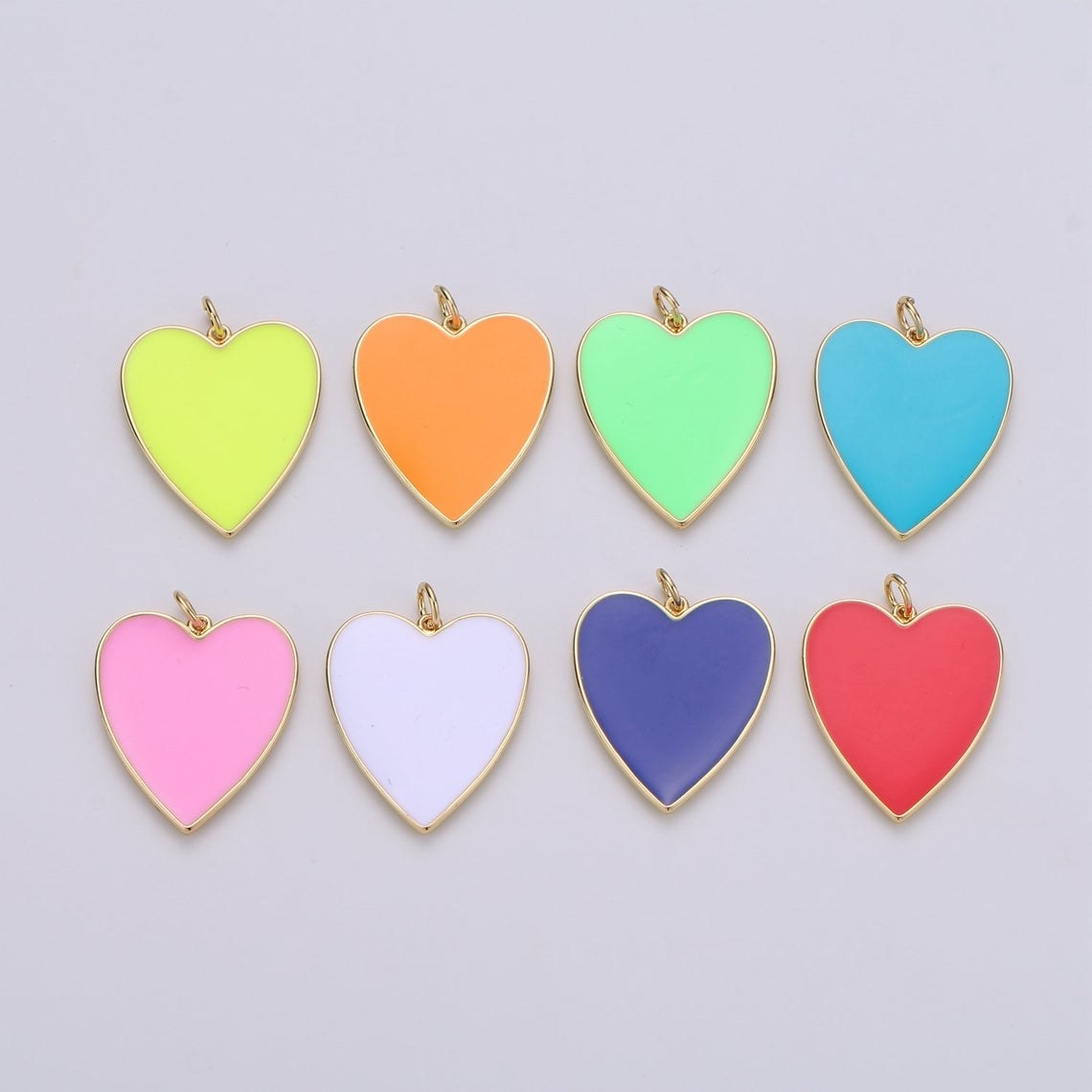 heart charms in various colors with gold colored backs