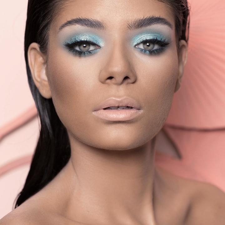 A model wearing a light blue eyeshadow look