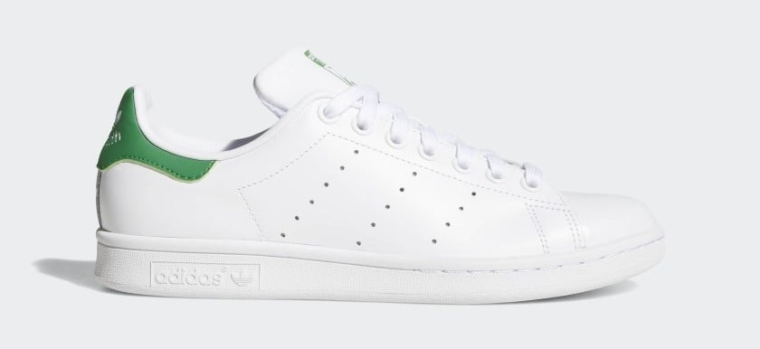 The white sneakers with green accents