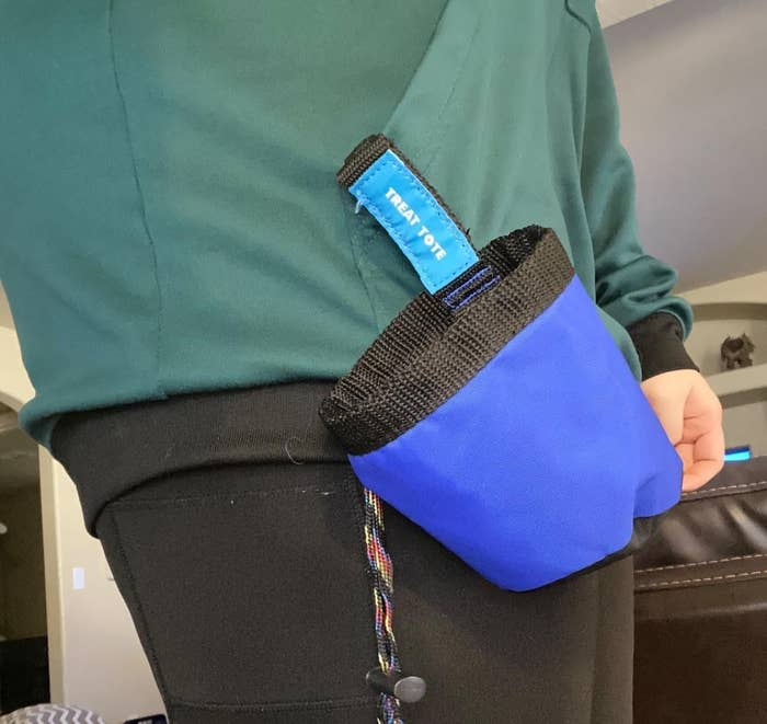The pouch attached at someone's belt