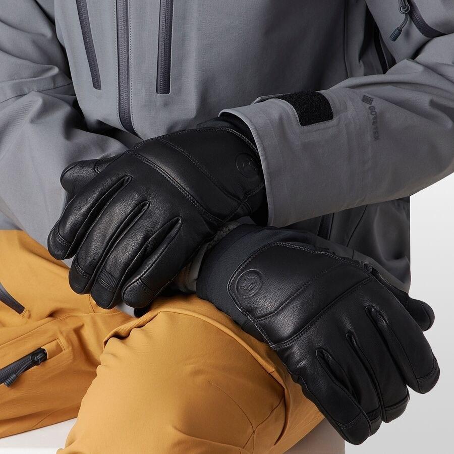 model wearing black faux leather gloves