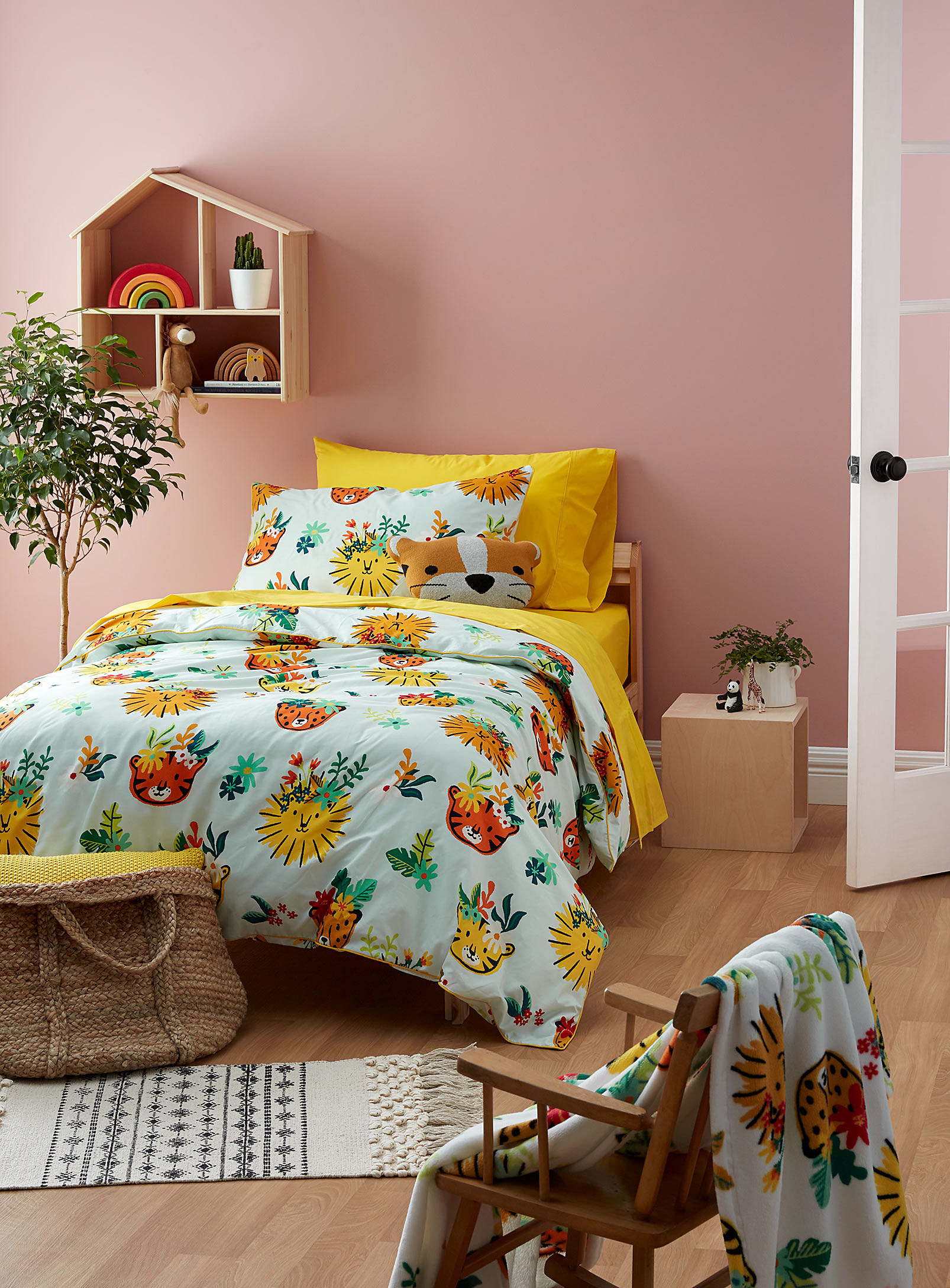 A duvet set with illustrated tiger faces on it