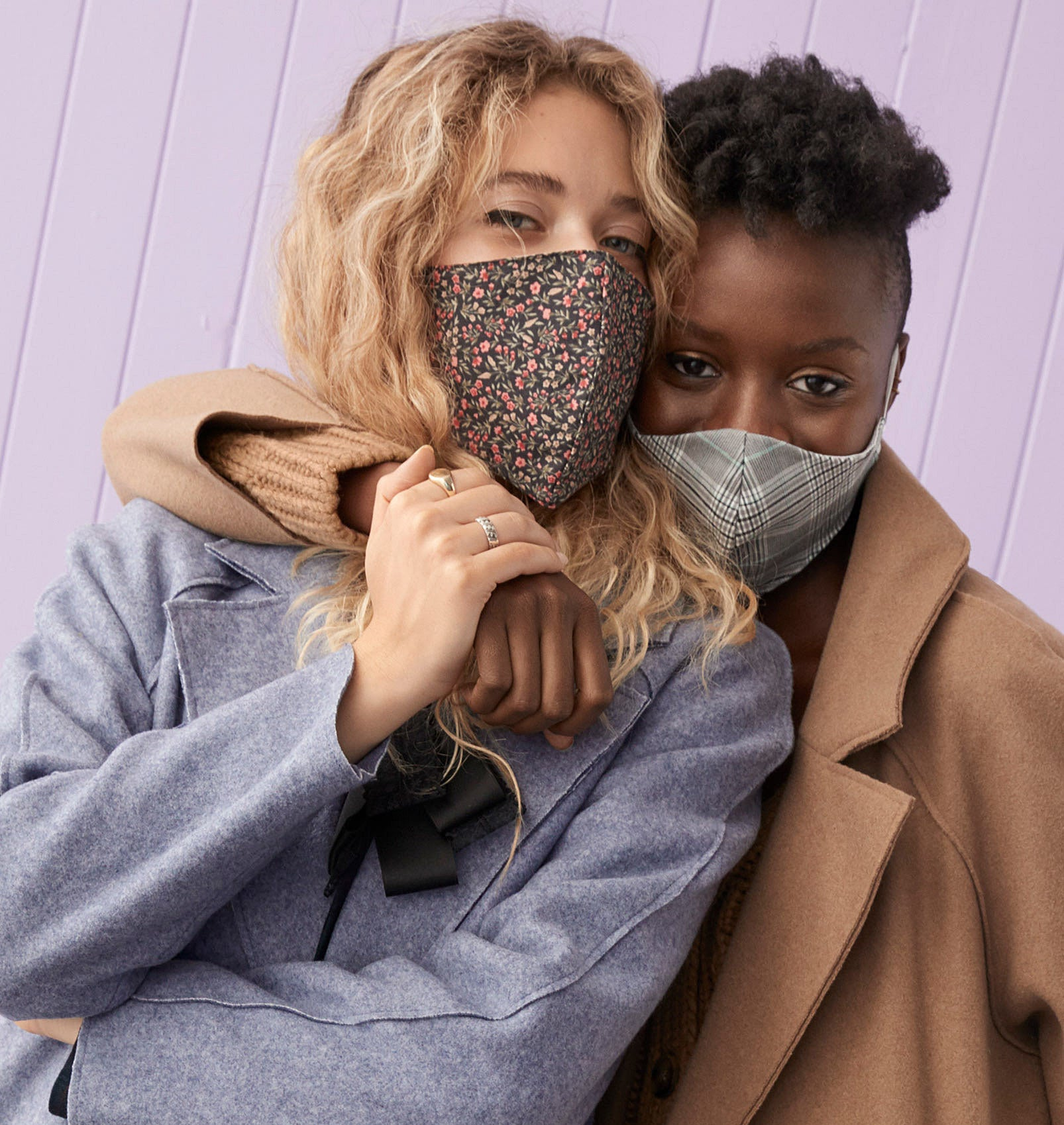 Two people wearing jackets and face masks