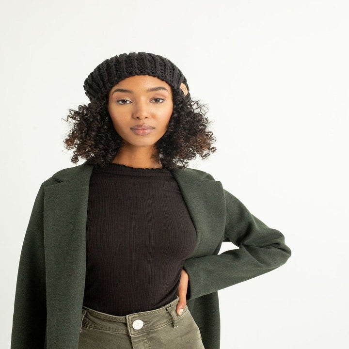 model wearing the black knit beanie with shirt and jacket