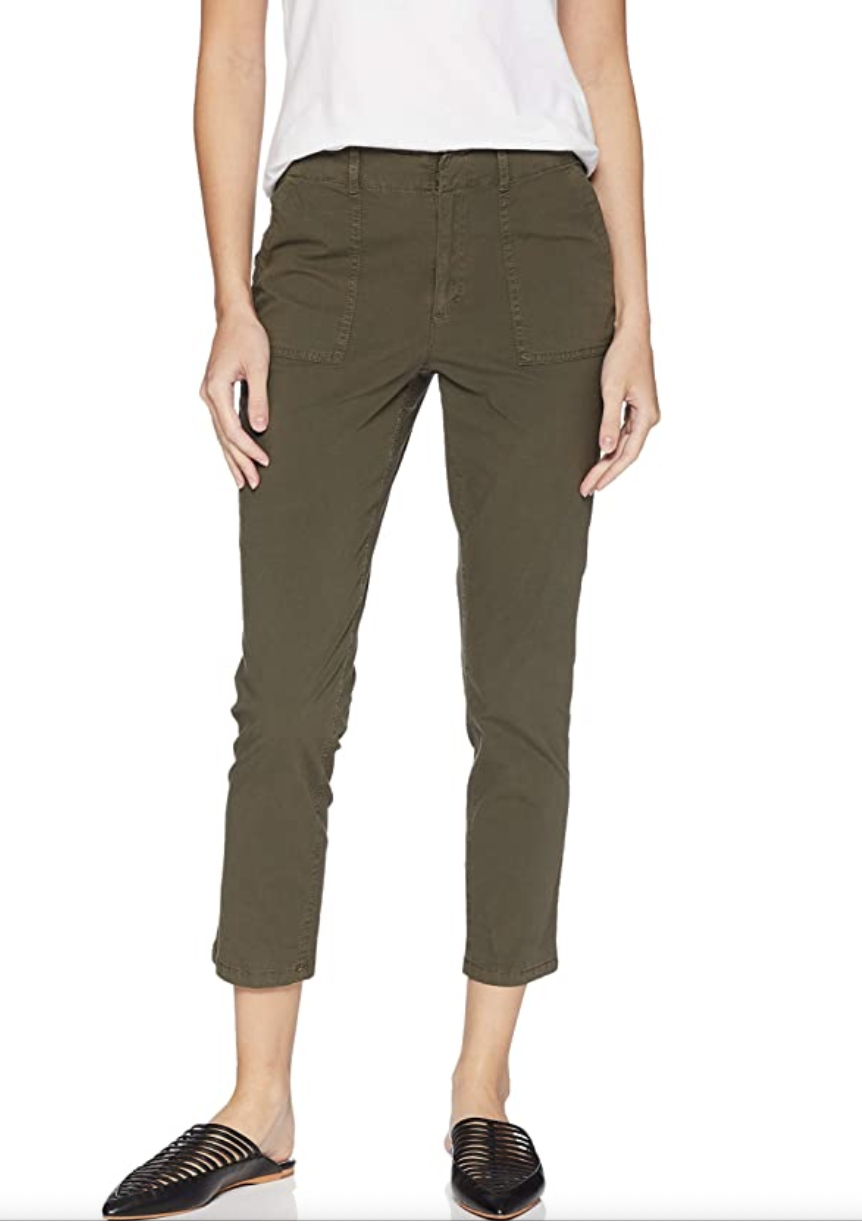 Model in olive green pants that fall above the ankle