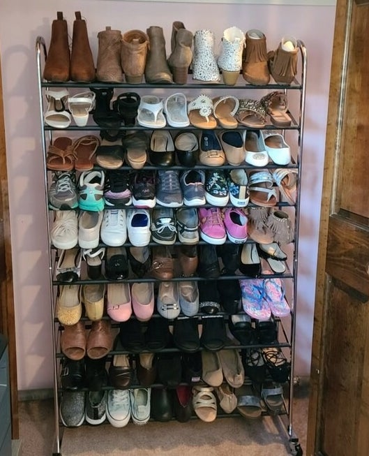 Reviewer's picture of the shoe rack filled with shoes