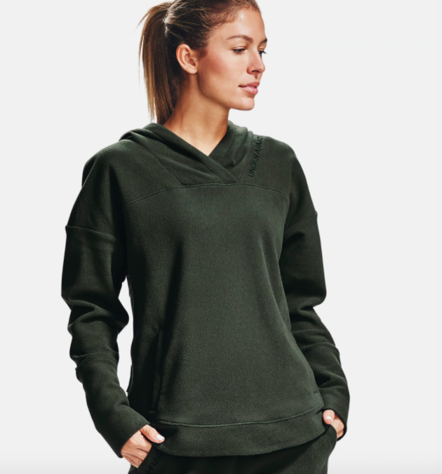 model wearing UA fleece hoodie in baroque green
