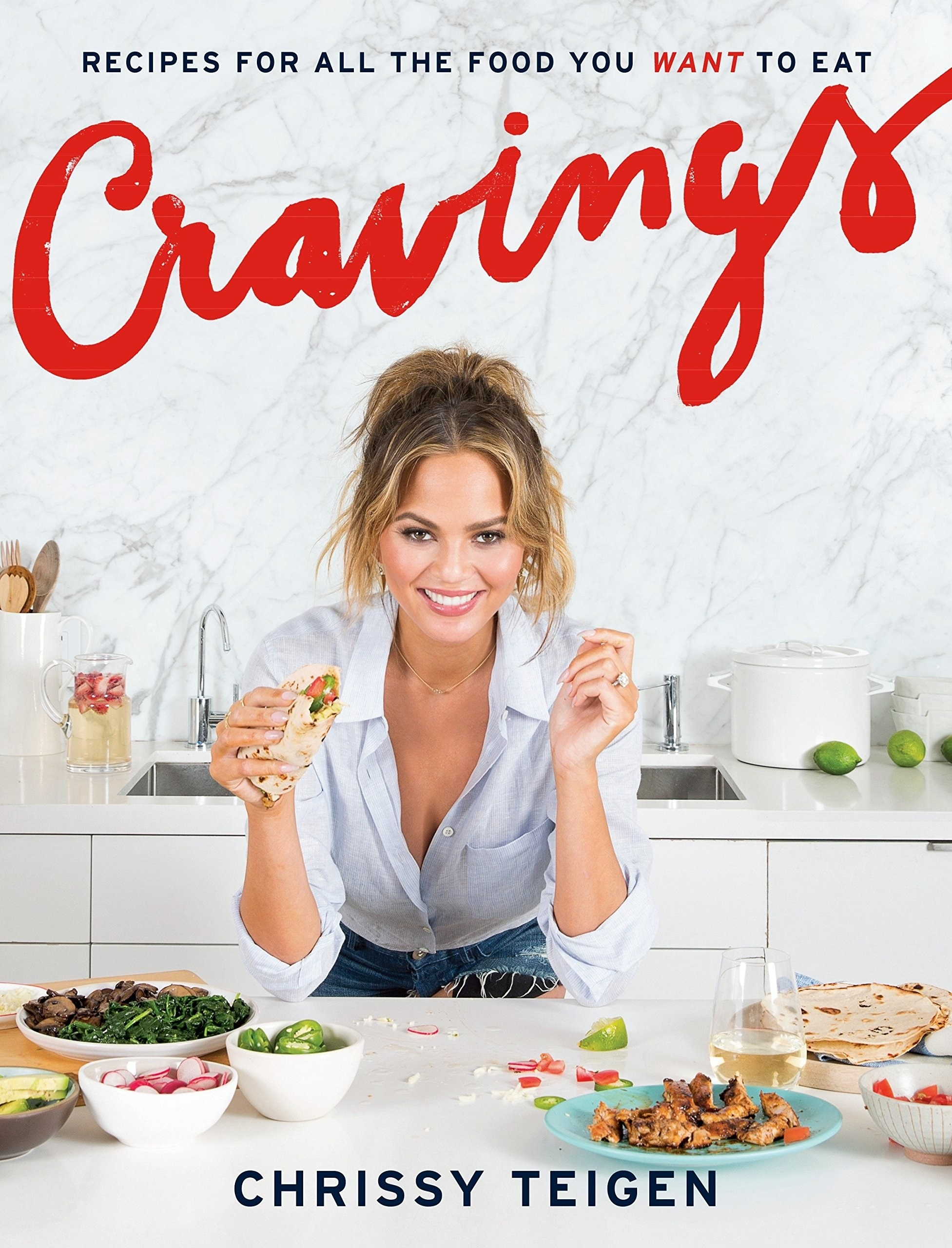 Chrissy Teigen on the cover of her cookbook