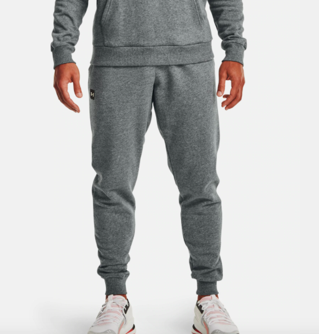 model wearing UA fleece joggers in pitch gray light heather
