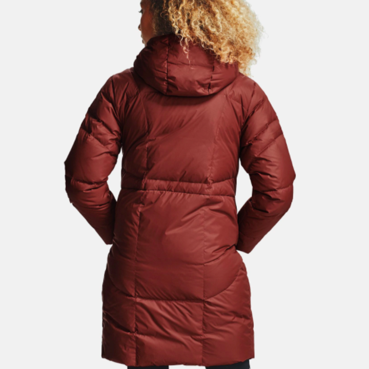 back of model wearing UA down parka in cinna red