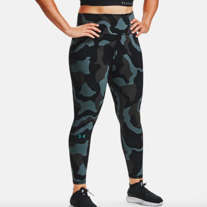model wearing UA rush camo leggings