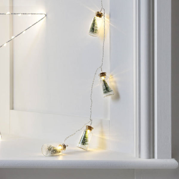 string lights with bottled trees