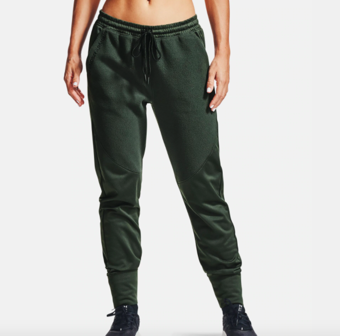 model wearing UA recover fleece pants in baroque green