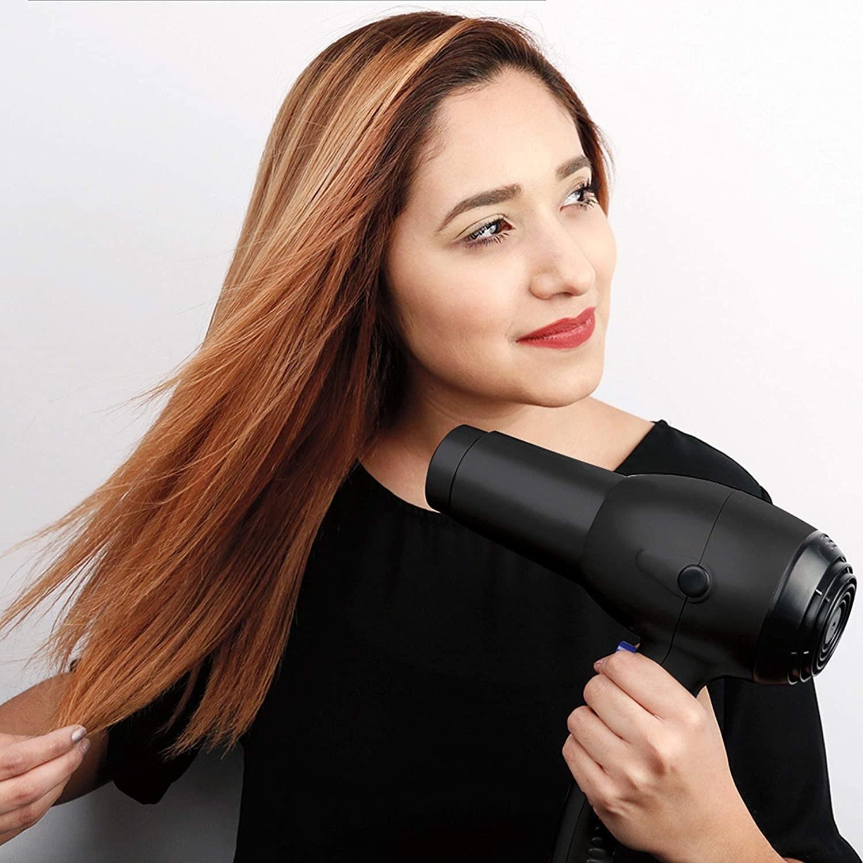 A person blowdries their hair