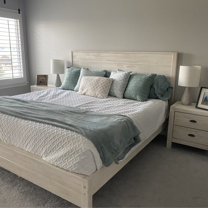Reviewer's picture of the wooden bed
