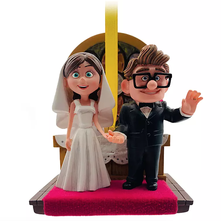 an ornament of ellie and carl getting married