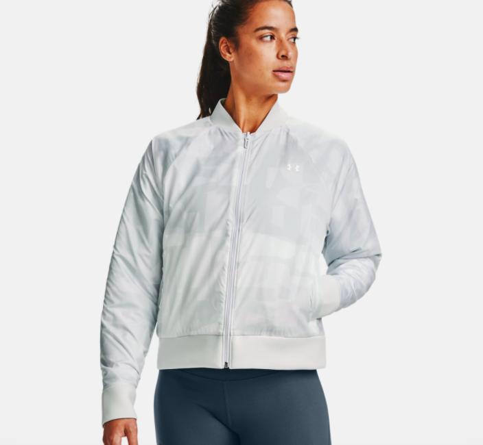 model wearing UA reversible bomber jacket