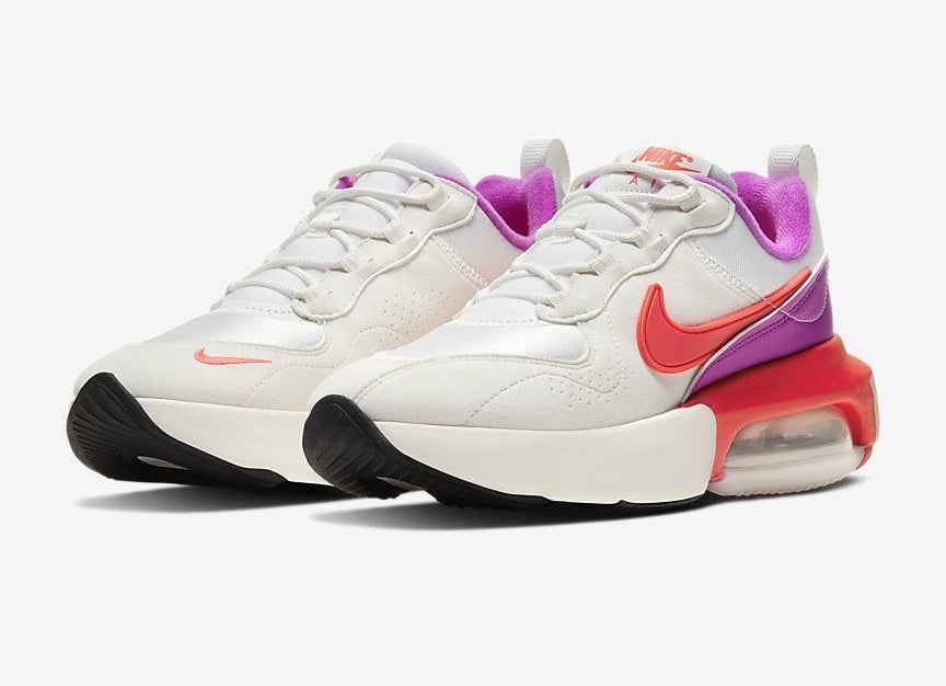 The shoes in white with accents of purple and red