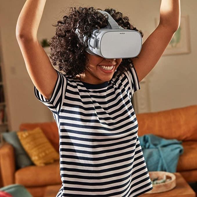Girl wearing the Oculus headset.