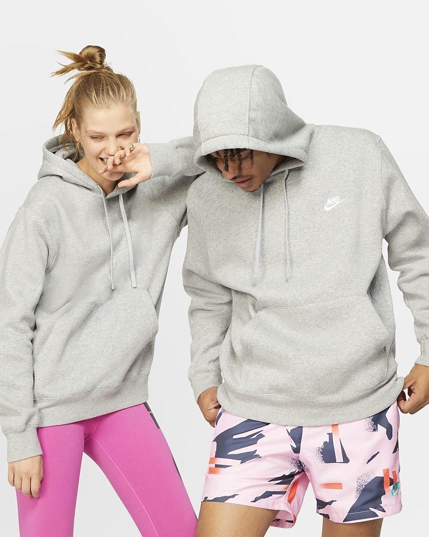 Two models both wearing the hoodie in grey