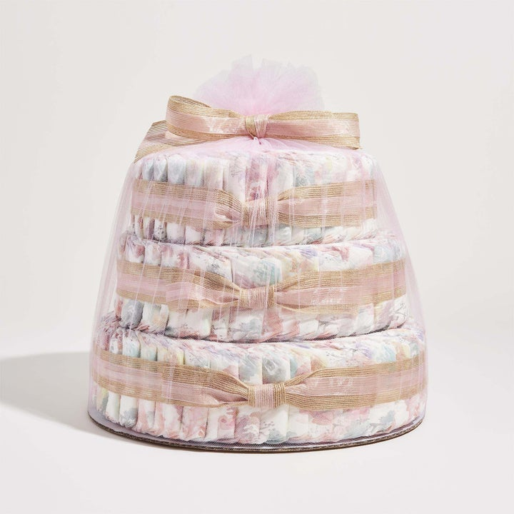 A three-tier cake made of diapers and wrapped in tulle