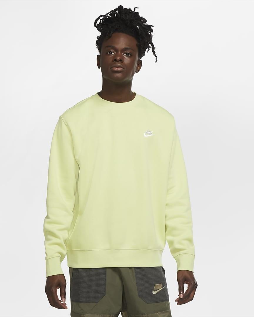 Model wearing the crewneck sweatshirt in lime green