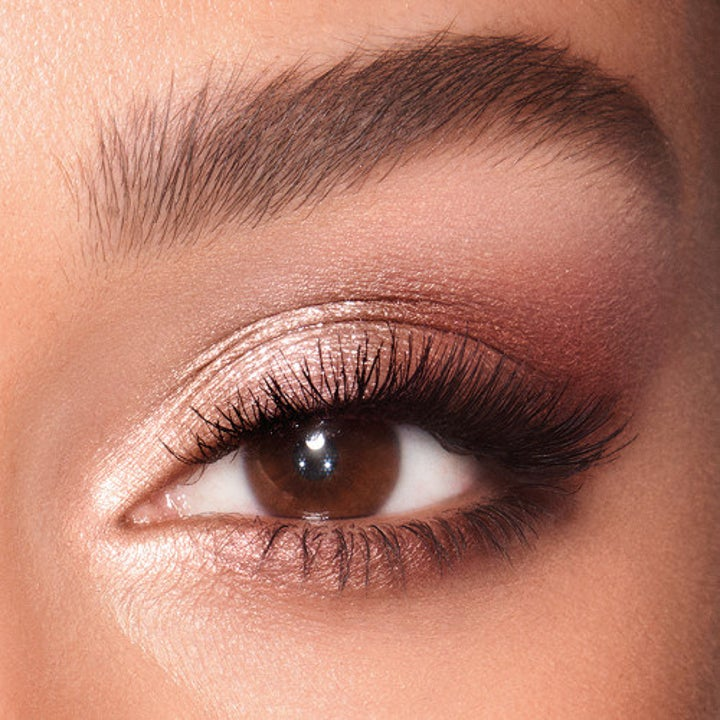 Model wearing the palette to create a pink-brown smokey eye