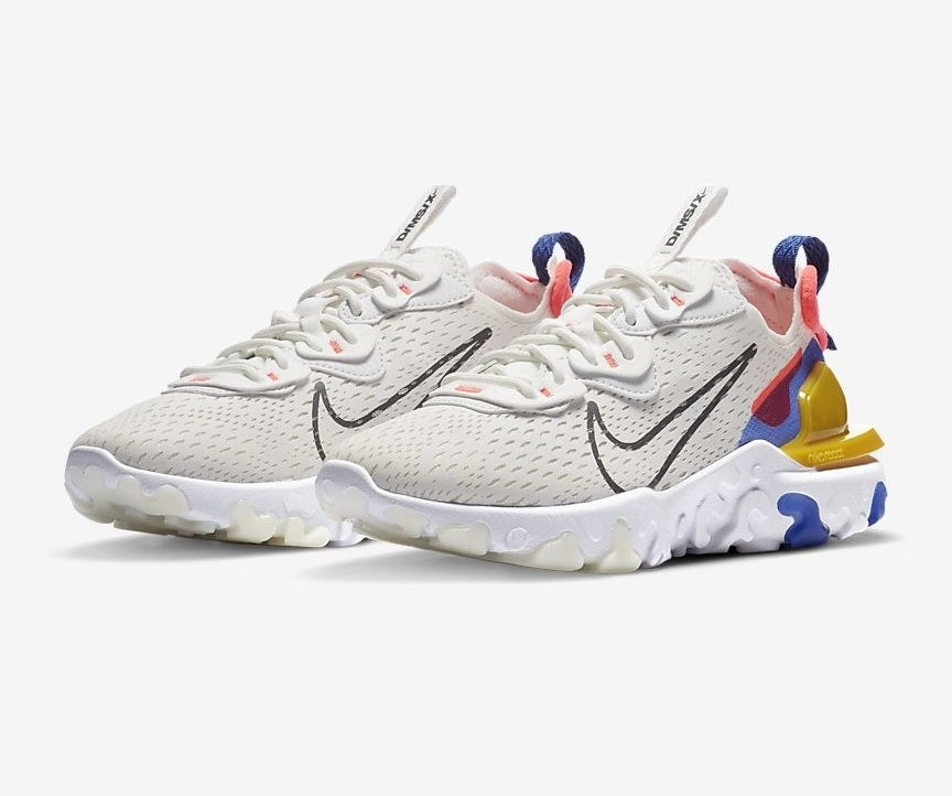 the react vision sneakers in white with accents of blue, red, and yellow