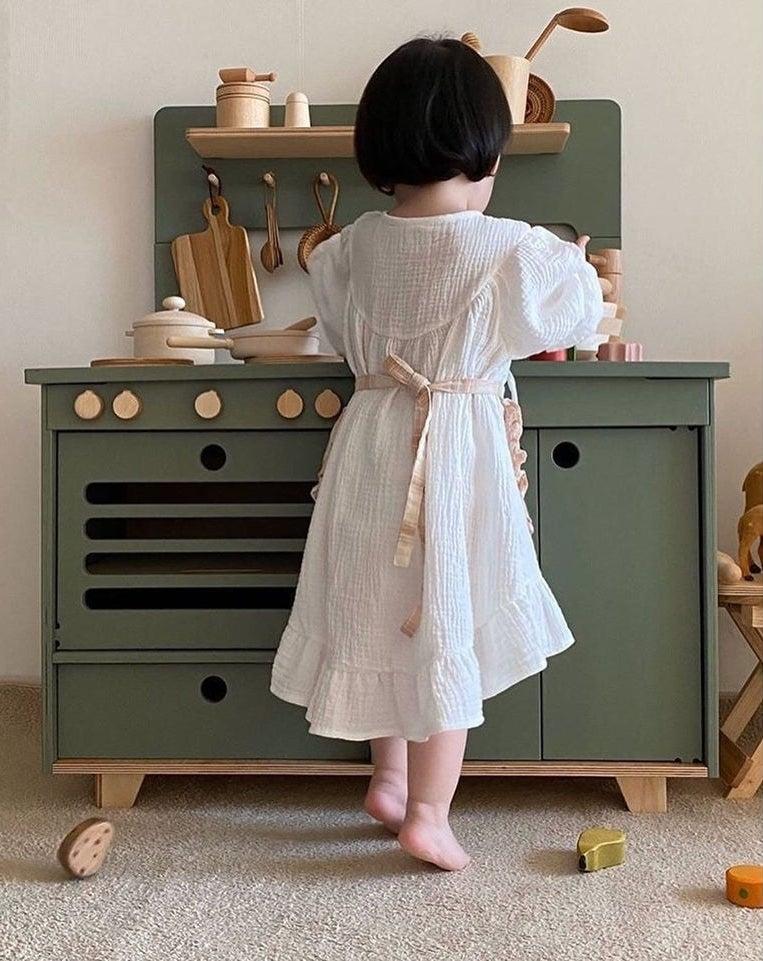 green wooden kitchen set