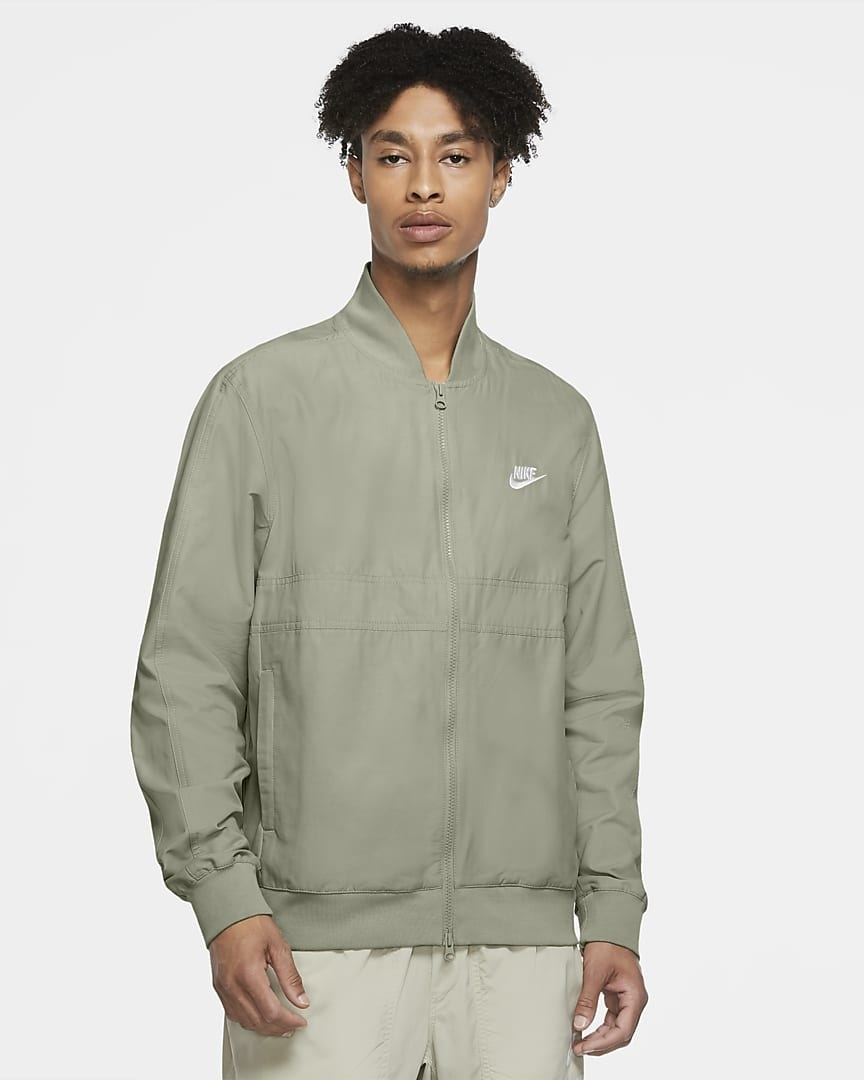 Model wearing the bomber-style jacket in light green